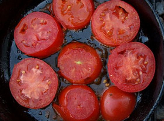 Hot tomato slices in skillet
